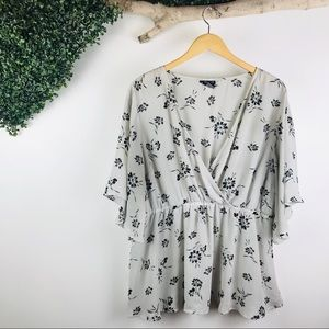 Torrid | floral gray peplum faux wrap top blouse